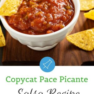 Small bowl of copycat pace picante salsa recipe with chips around the bowl and one chip scooping in the bowl. Includes a text overlay that says copycat pace picante salsa recipe