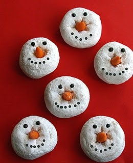 These cute snowman donuts are an easy christmas breakfast. Made with powdered donuts, icing, and candy corn.