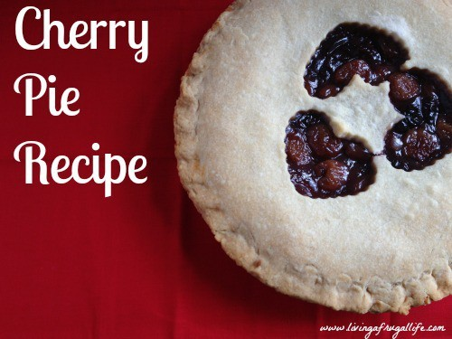 cherry pie with heart cut outs in the crust. The pie is on a red background with Cherry Pie Recipe written on it.