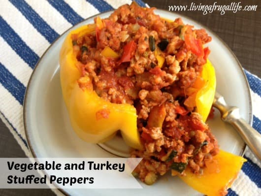 Make these really healthy vegetable and turkey stuffed peppers recipe. They are made with zucchini, peppers, and ground turkey in a pepper shell.