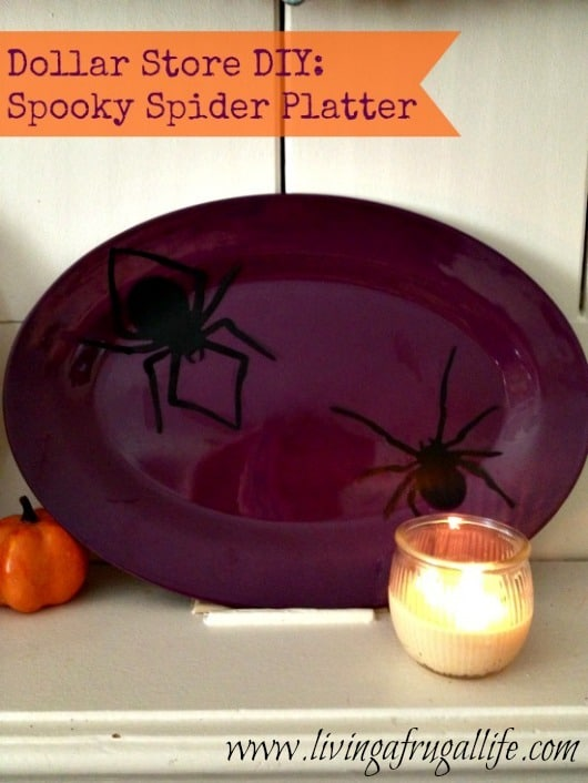 Picture of a fun halloween craft of a Spider Platter craft for the home the is a purple plate with black spiders glued on.