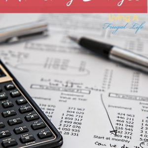 """calculator on a printed out budget with a pen on top. Text overlayed that says """"How to Make a Monthly Budget: a beginners guide"""""""