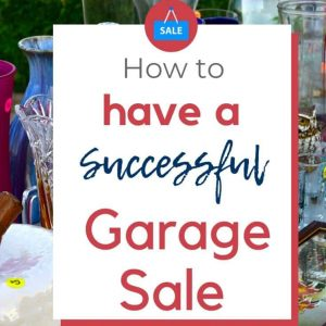 articles of clothing and dishes on a table. there is a text overlay on a white square that says how to have a successful garage sale.