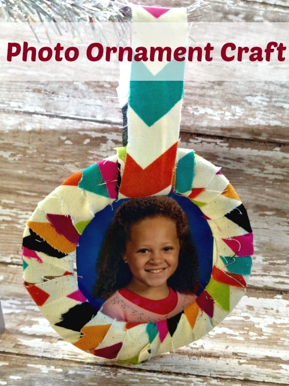 Make this photo ornament to remember the fun ages of your kids or to show off your family picture! Made with fabric, cardboard, and more!