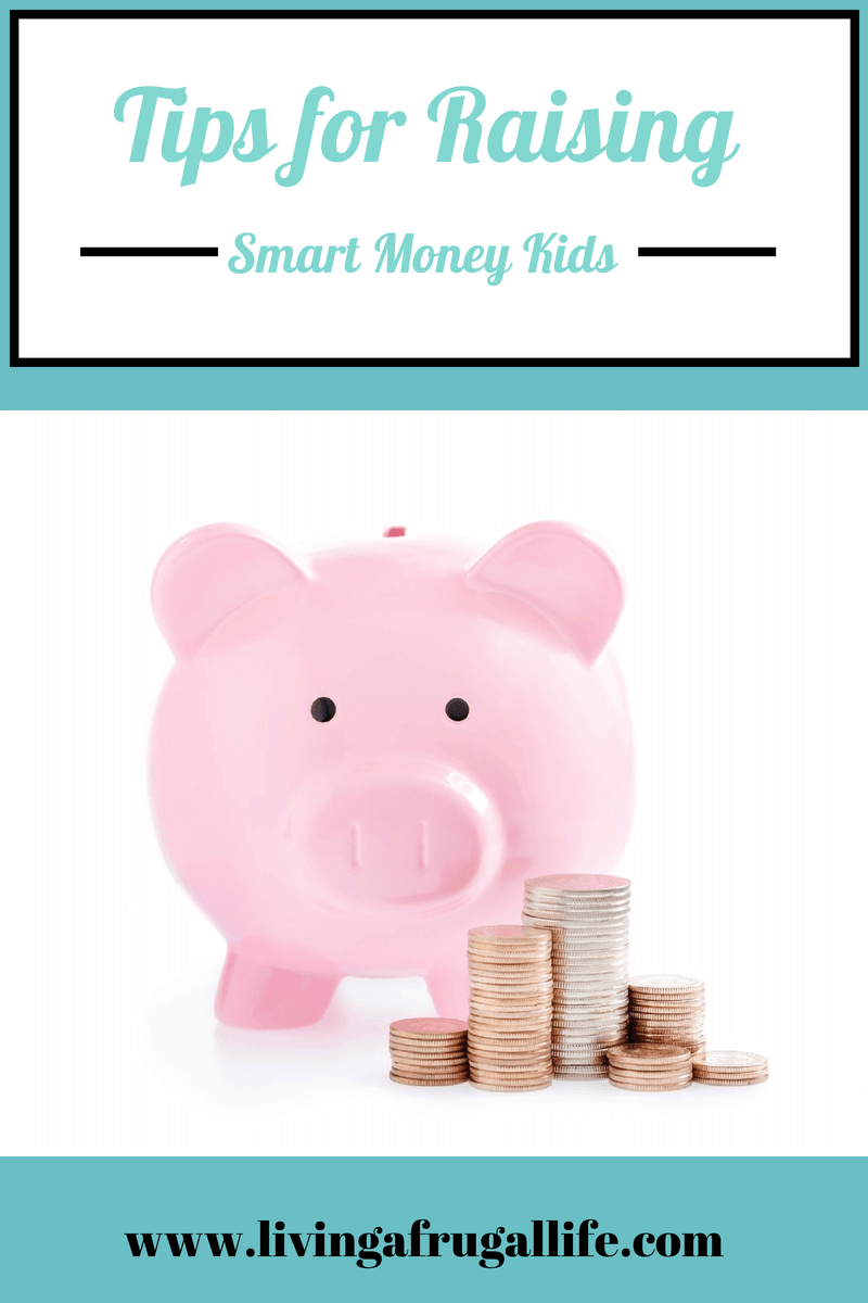 Pink piggy bank  with stacks of quarters, pennies, and dimes next to it.  There is a text overlay that says tips for raising smart money kids.