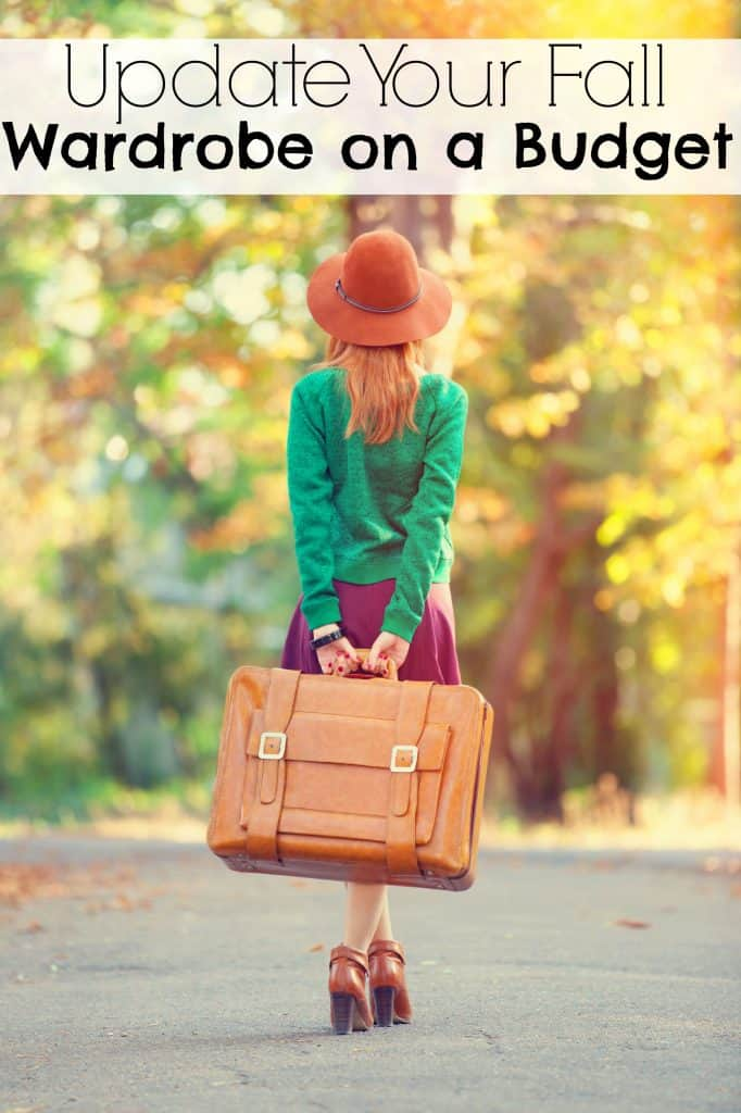 Girl standing with trees with fall leaves around her. She is wearing a green sweater and pink skit, a perfect example of a way to update your fall capsule wardrobe on a budget.