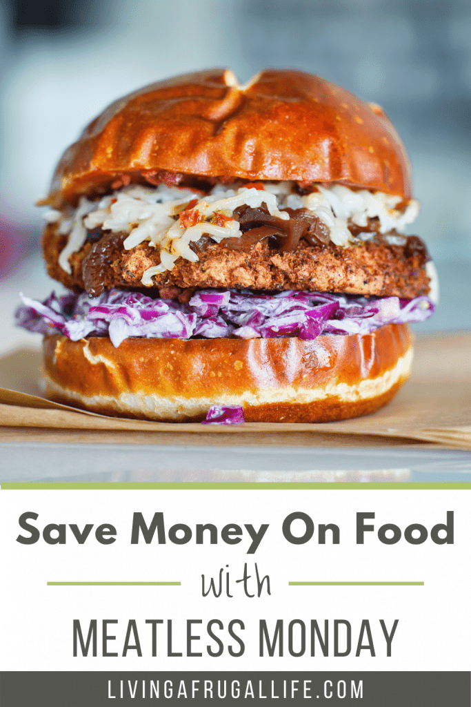 a veggie burger with cold slaw on a brown paper with text that says save money on food with meatless monday